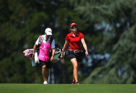 EVIAN, FRANCE - JULY 26:  Paula Creamer of USA and her caddie walk towards her ball on the fifth hole during the third round of the Evian Masters at the Evian Masters Golf Club on July 26, 2008 in Evian, France.  (Photo by Andrew Redington/Getty Images)