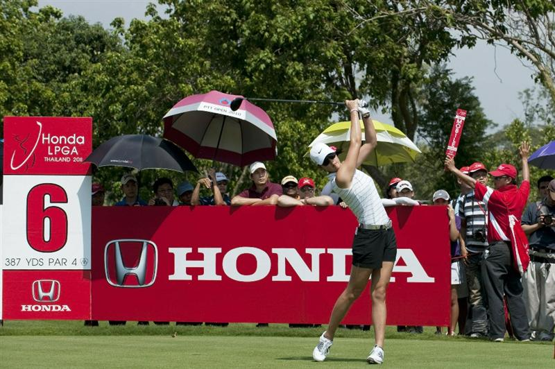 CHON BURI, THAILAND - FEBRUARY 19:  Michelle Wie of USA tees off on the 6th hole during day three of the LPGA Thailand at Siam Country Club on February 19, 2011 in Chon Buri, Thailand.  (Photo by Victor Fraile/Getty Images)