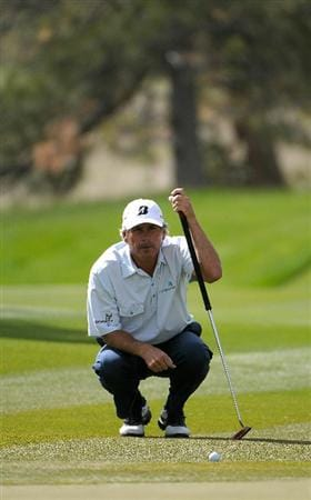 PARKER, CO. - MAY 27:  Fred Couples lines up a putt for birdie on the  14th hole  during the first round of the Senior PGA Championship at the Colorado Golf Club  on May 27, 2010 in Parker, Colorado.  (Photo by Marc Feldman/Getty Images)