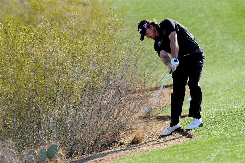 MARANA, AZ - FEBRUARY 24:  Graeme McDowell of Northern Ireland hits a shot after taking a drop on the first hole during the second round of the Accenture Match Play Championship at the Ritz-Carlton Golf Club on February 24, 2011 in Marana, Arizona.  (Photo by Stuart Franklin/Getty Images)
