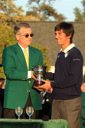 AUGUSTA, GA - APRIL 11:  Augusta National Chairman William Porter 'Billy' Payne presents the Silver Cup to Low Amateur Matteo Manassero of Italy during the green jacket presentation after the final round of the 2010 Masters Tournament at Augusta National Golf Club on April 11, 2010 in Augusta, Georgia.  (Photo by David Cannon/Getty Images)
