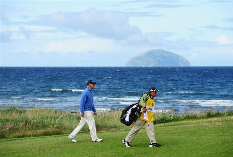 TURNBERRY, SCOTLAND - JULY 19:  Tom Lehman of USA walks up the 2nd hole with his caddy during the final round of the 138th Open Championship on the Ailsa Course, Turnberry Golf Club on July 19, 2009 in Turnberry, Scotland.  (Photo by Stuart Franklin/Getty Images)