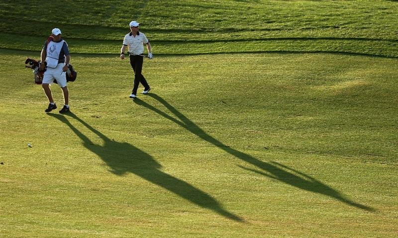 VILAMOURA, PORTUGAL - OCTOBER 16:  Simon Dyson of England walks with his caddie Guy Tilson on the tenth hole during the second round of the Portugal Masters at the Oceanico Victoria Golf Course on October 16, 2009 in Vilamoura, Portugal.  (Photo by Andrew Redington/Getty Images)