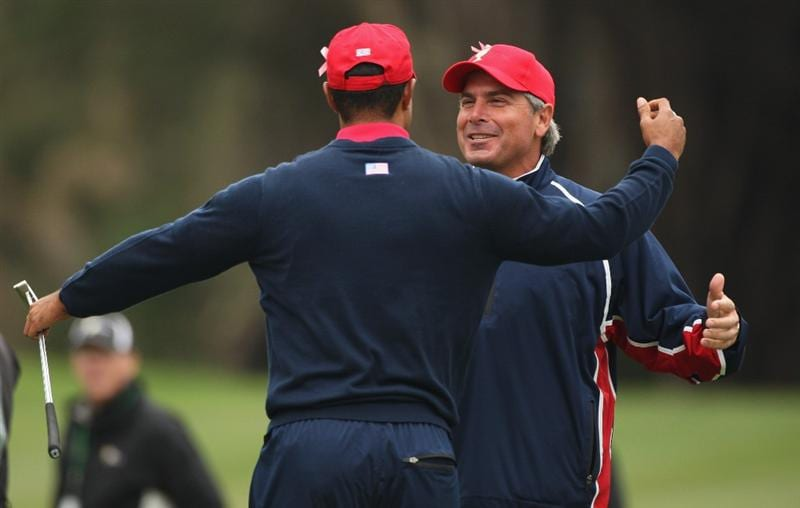 SAN FRANCISCO - OCTOBER 11:  Fred Couples, Captain of the USA Team rushes to congratulate Tiger Woods after winning his Singles Match against Y. E. Yang of the International Team and winning The Presidents Cup at Harding Park Golf Course on October 11, 2009 in San Francisco, California.  (Photo by Warren Little/Getty Images)