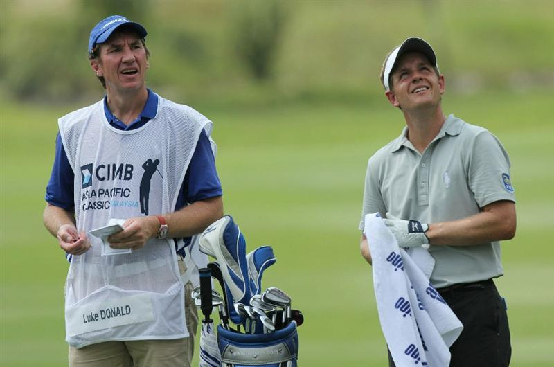 KUALA LUMPUR, MALAYSIA - OCTOBER 28: Luke Donald of England and his caddie look for the direction of the wind during day one of the CIMB Asia Pacific Classic at The MINES Resort & Golf Club on October 28, 2010 in Kuala Lumpur, Malaysia. (Photo by Stanley Chou/Getty Images)