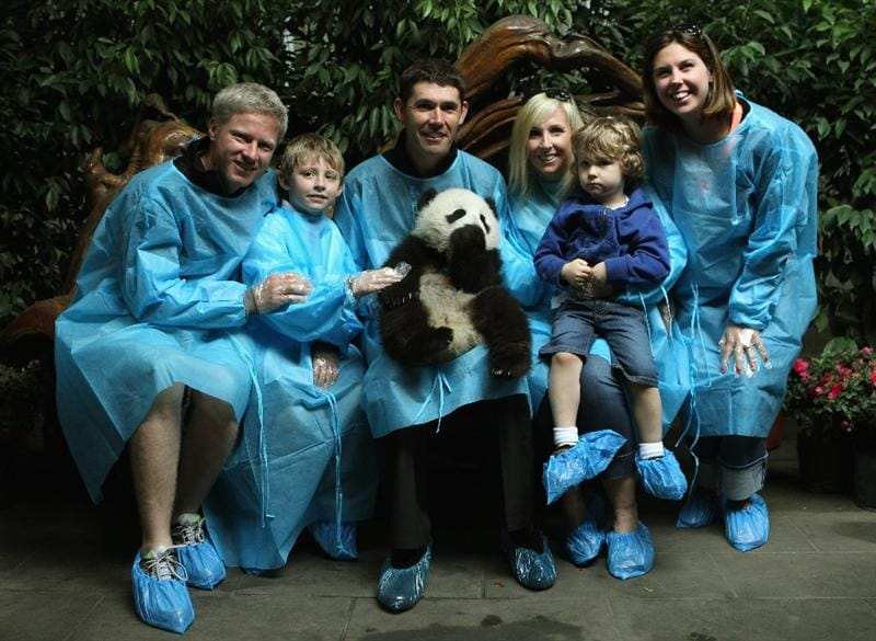 CHENGDU, CHINA - APRIL 19:  Padraig Harrington of Ireland and his family, pose for photos with a baby Panda during a visit to the Chengdu Research Base of Giant Panda Breeding on April 19, 2011 in Chengdu, China.  (Photo by Ian Walton/Getty Images)