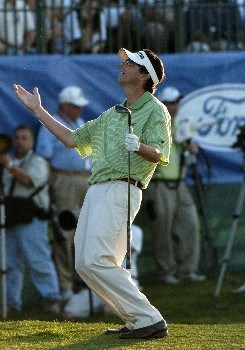 Billy Andrade misses a birdie putt on the 18th green  during third-round competition March 5, 2005  at the Ford Championship at Doral in Miami.