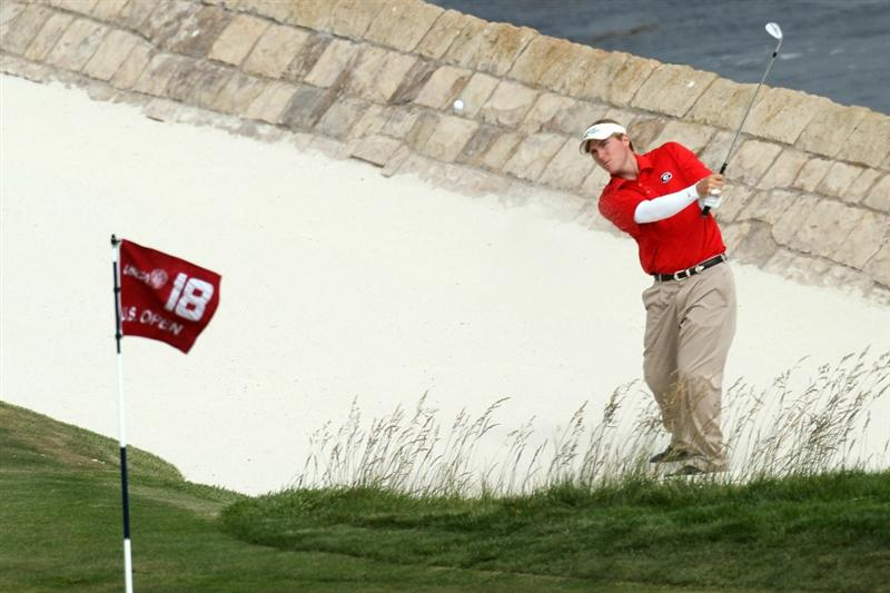 PEBBLE BEACH, CA - JUNE 20:  Amateur Russell Henley plays a bunker shot on the 18th hole during the final round of the 110th U.S. Open at Pebble Beach Golf Links on June 20, 2010 in Pebble Beach, California.  (Photo by Stephen Dunn/Getty Images)