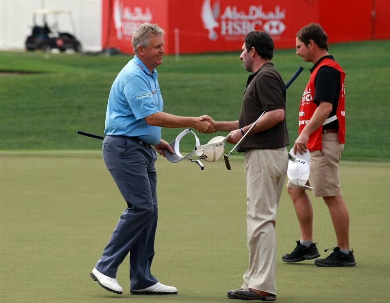 ABU DHABI, UNITED ARAB EMIRATES - JANUARY 21: Colin Montgomerie of Scotland shakes hands with his playing partner Jose Maria Olazabal of Spain during the second round of the 2011 Abu Dhabi HSBC Golf Championship held at the Abu Dhabi Golf Club on January 21, 2011 in Abu Dhabi, United Arab Emirates.  (Photo by David Cannon/Getty Images)