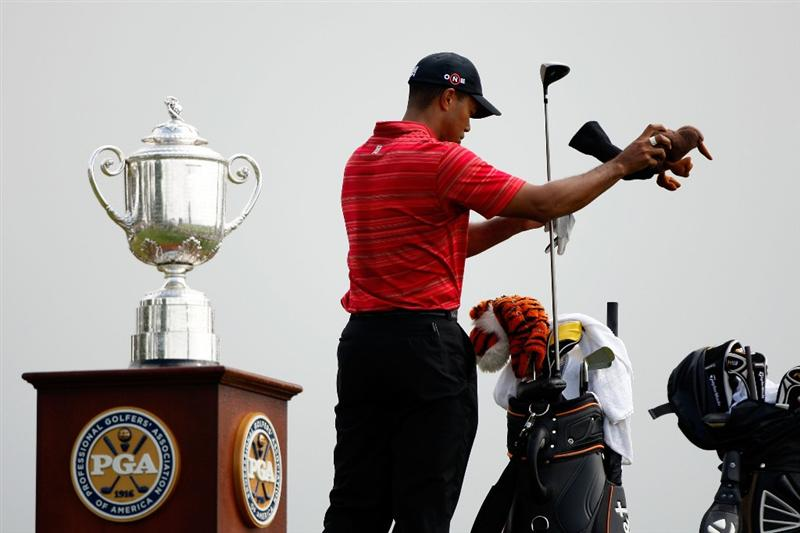 CHASKA, MN - AUGUST 16:  Tiger Woods pulls a club alongside the Wanamaker Trophy on the first tee during the final round of the 91st PGA Championship at Hazeltine National Golf Club on August 16, 2009 in Chaska, Minnesota.  (Photo by Streeter Lecka/Getty Images)