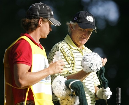 DULUTH, GA - MAY 16:  Greg Norman takes a club from his son and caddie Gregory (L) before his tee shot on the third hole during the second round of the AT&T Classic at TPC Sugarloaf on May 16, 2008 in Duluth, Georgia.  (Photo by Matt Sullivan/Getty Images)