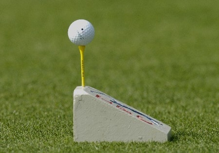 Mike McCullough  tees his ball on a first hole tee marker during