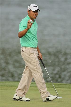 CHARLOTTE, NC - MAY 07:  Andres Romero of Argentina waves to the gallery on the 17th green during the third round of the Wells Fargo Championship at the Quail Hollow Club on May 7, 2011 in Charlotte, North Carolina.  (Photo by Scott Halleran/Getty Images)