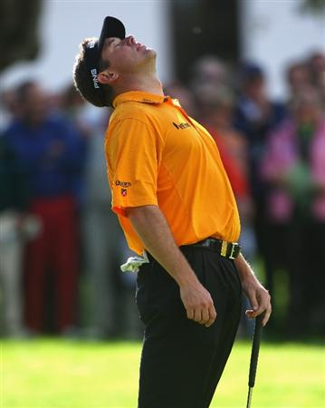 SOTOGRANDE, SPAIN - NOVEMBER 02:  Lee Westwood of England looks dejected after missing a putt on the 18th hole during the third round of the Volvo Masters at Valderrama Golf Club on November 2, 2008 in Sotogrande, Spain.  (Photo by Andrew Redington/Getty Images)