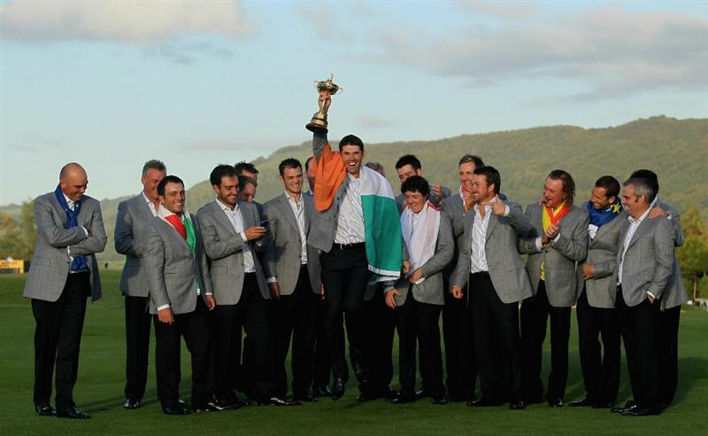 NEWPORT, WALES - OCTOBER 04:  European Team member Padraig Harrington poses with the Ryder Cup alongside his team mates following Europe's 14.5 to 13.5 victory over the USA at the 2010 Ryder Cup at the Celtic Manor Resort on October 4, 2010 in Newport, Wales.  (Photo by Andy Lyons/Getty Images)