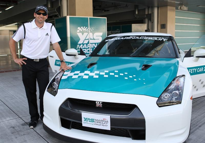 ABU DHABI - UNITED ARAB EMIRATES - JANUARY 20:   Sergio Garcia poses next to a Yas Marina Formula One circuit safety car at the finish straight of the Abu Dhabi Grand Prix Track during the Etihad Whack on the Track at the Abu Dhabi Grand Prix Track on January 20, 2010 in Abu Dhabi, United Arab Emirates.  (Photo by Jack Jacob/Getty Images for Eithad)