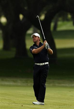 SOTOGRANDE, SPAIN - OCTOBER 28:  Graeme McDowell of Northern Ireland plays into the 1st green during the first round of the Andalucia Valderrama Masters at Club de Golf Valderrama on October 28, 2010 in Sotogrande, Spain.  (Photo by Richard Heathcote/Getty Images)