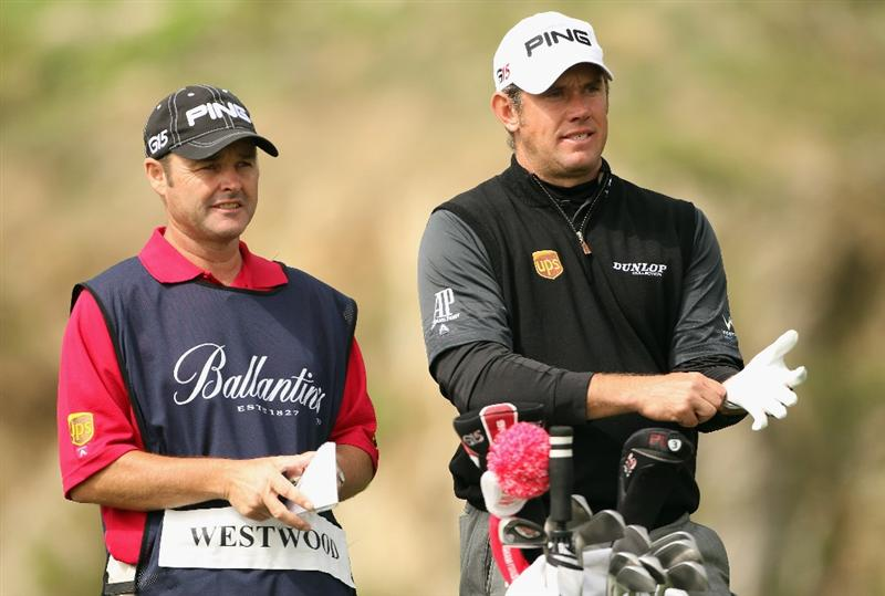 ICHEON, SOUTH KOREA - MAY 01:  Lee Westwood of England with his caddie Billy Foster during the final round on his way to victory in the Ballantine's Championship at Blackstone Golf Club on May 1, 2011 in Icheon, South Korea.  (Photo by Andrew Redington/Getty Images)