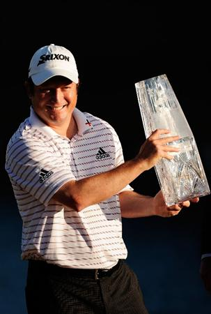 PONTE VEDRA BEACH, FL - MAY 09:  Tim Clark of South Africa smiles while holding the trophy during the trophy presentation after winning THE PLAYERS Championship held at THE PLAYERS Stadium course at TPC Sawgrass on May 9, 2010 in Ponte Vedra Beach, Florida.  (Photo by Sam Greenwood/Getty Images)