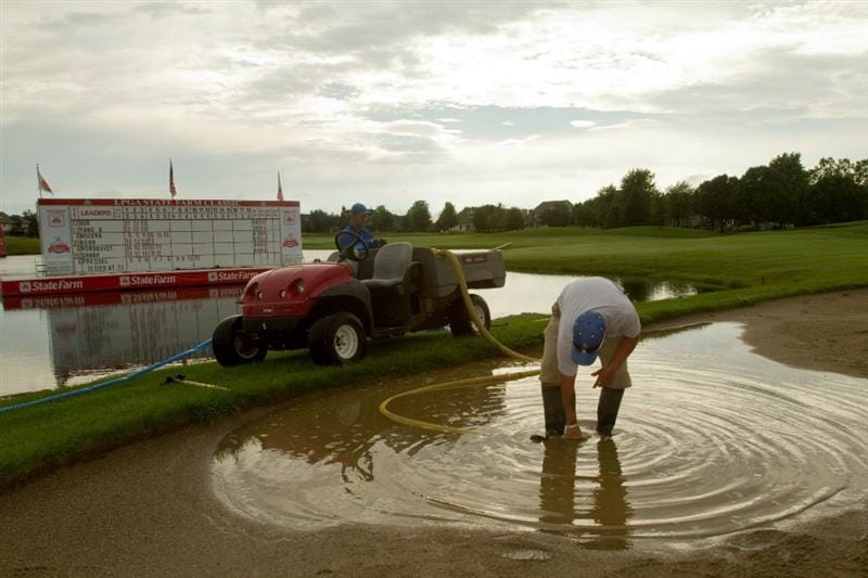 SPRINGFIELD, IL - JUNE 12: Members of the grounds crew pump water out of bunkers at the 18th hole after thunderstorms suspended the third round of the LPGA State Farm Classic at Panther Creek Country Club on June 12, 2010 in Springfield, Illinois. With 44 players still on the course, completion of the third round of play has been postponed until Sunday, June 13.  (Photo by Darren Carroll/Getty Images)