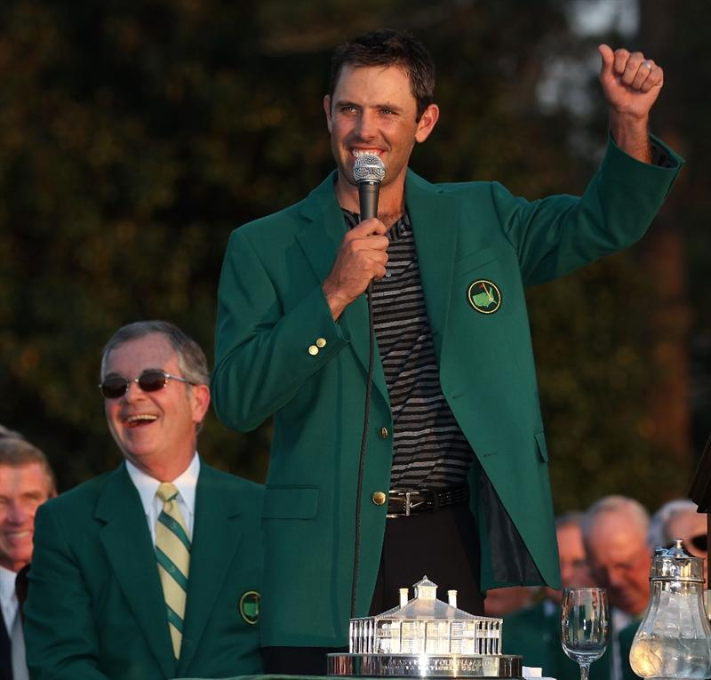 AUGUSTA, GA - APRIL 10:  Charl Schwartzel of South Africa speaks to the gallery at the green jacket presentation as William Porter Payne looks on after his two-stroke victory at the 2011 Masters Tournament at Augusta National Golf Club on April 10, 2011 in Augusta, Georgia.  (Photo by Andrew Redington/Getty Images)