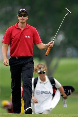 CHASKA, MN - AUGUST 15:  Henrik Stenson of Sweden walks with his caddie Fanny Sunneson to ninth green during the third round of the 91st PGA Championship at Hazeltine National Golf Club on August 15, 2009 in Chaska, Minnesota.  (Photo by Jamie Squire/Getty Images)