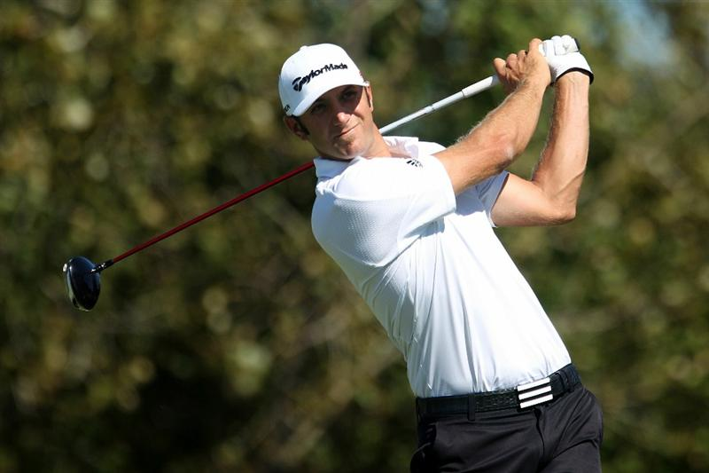 LEMONT, IL - SEPTEMBER 12:  Dustin Johnson tees off on the eighth hole during the final round of the BMW Championship at Cog Hill Golf & Country Club on September 12, 2010 in Lemont, Illinois.  (Photo by Scott Halleran/Getty Images)