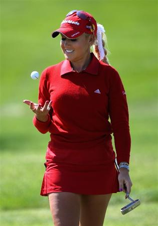 SPRINGFIELD, IL - JUNE 05:  Natalie Gulbis smiles after making a birdie putt on the sixth hole during the second round of the LPGA State Farm Classic golf tournament at Panther Creek Country Club on June 5, 2009 in Springfield, Illinois.  (Photo by Christian Petersen/Getty Images)