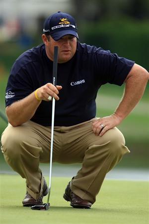 ORLANDO, FL - MARCH 27:  Jason Gore lines up a putt on the 17th green during the second round of the Arnold Palmer Invitational at the Bay Hill Club & Lodge on March 27, 2009 in Orlando, Florida.  (Photo by Scott Halleran/Getty Images)
