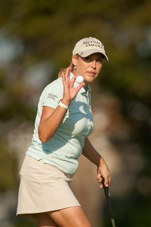 PRATTVILLE, AL - OCTOBER 9: Cristie Kerr facknowledges the gallery at the 16th hole during the third round of the Navistar LPGA Classic at the Senator Course at the Robert Trent Jones Golf Trail on October 9, 2010 in Prattville, Alabama. (Photo by Darren Carroll/Getty Images)