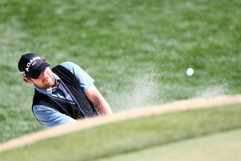 MARANA, AZ - FEBRUARY 25:  Ryan Moore hits from a bunker on the fifth hole during the third round of the Accenture Match Play Championship at the Ritz-Carlton Golf Club on February 25, 2011 in Marana, Arizona.  (Photo by Sam Greenwood/Getty Images)