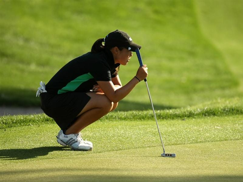 RANCHO MIRAGE, CA - APRIL 02:  Amateur Tiffany Joh lines up her putt on the 17th hole during the first round of the Kraft Nabisco Championship at Mission Hills Country Club on April 2, 2009 in Rancho Mirage, California.  (Photo by Stephen Dunn/Getty Images)