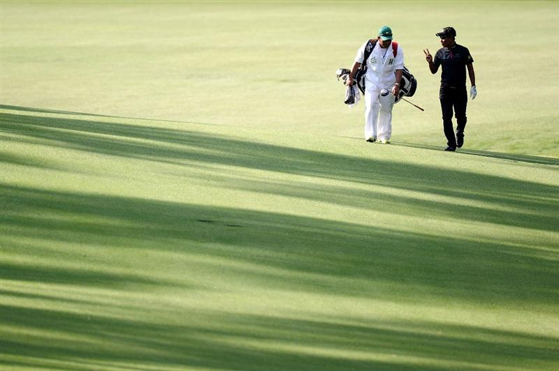 AUGUSTA, GA - APRIL 07:  Thongchai Jaidee of Thailand (R) walks with his caddie Surawut Wannapintu during a practice round prior to the 2010 Masters Tournament at Augusta National Golf Club on April 7, 2010 in Augusta, Georgia.  (Photo by Harry How/Getty Images)