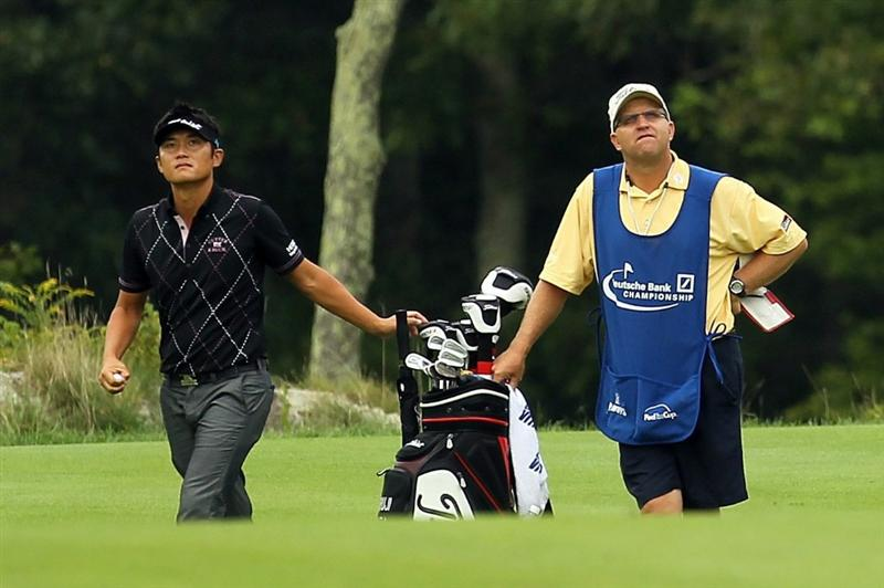 NORTON, MA - SEPTEMBER 03:  (L) Ryuji Imada of Japan looks at his shot on the 14th tee during the first round of the Deutsche Bank Championship at TPC Boston on September 3, 2010 in Norton, Massachusetts.  (Photo by Mike Ehrmann/Getty Images)