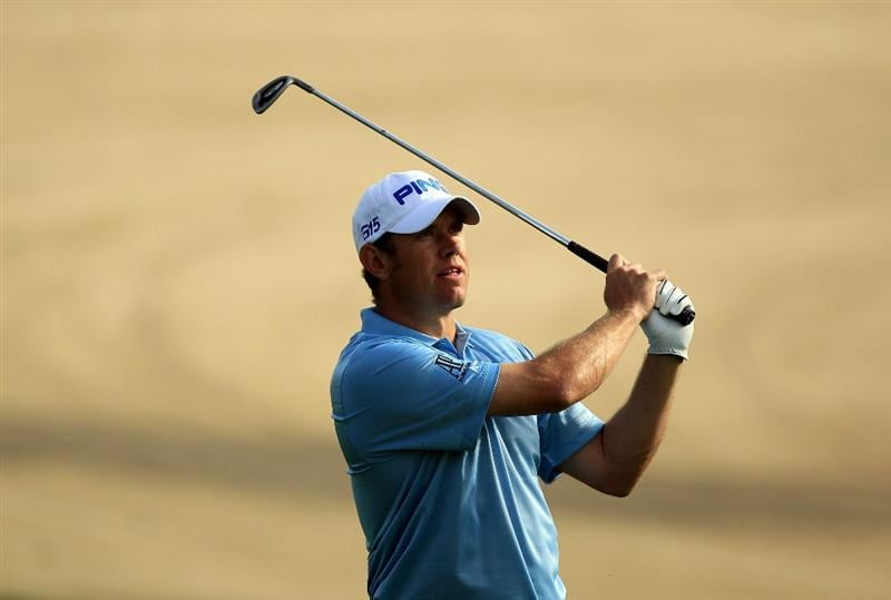 DUBAI, UNITED ARAB EMIRATES - FEBRUARY 11:  Lee Westwood of England plays his second shot at the 14th hole during the second round of the 2011 Omega Dubai Desert Classic on the Majilis Course at the Emirates Golf Club on February 11, 2011 in Dubai, United Arab Emirates.  (Photo by David Cannon/Getty Images)
