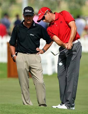 DUBAI, UNITED ARAB EMIRATES - NOVEMBER 21:  Sergio Garcia of Spain working on his short game with golf coach Peter Cowen before the third round of the Dubai World Championship, on the Earth Course, Jumeirah Golf Estates on November 21, 2009 in Dubai, United Arab Emirates  (Photo by David Cannon/Getty Images)