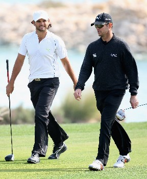 DOHA, QATAR - JANUARY 24:  Johan Edfors of Sweden (L) and Andrew Coltart of Scotland on the 14th  hole during the first round of the Commercial Bank Qatar Masters held at the Doha Golf Club on January 24, 2008 in Doha,Qatar.  (Photo by Ross Kinnaird/Getty Images)
