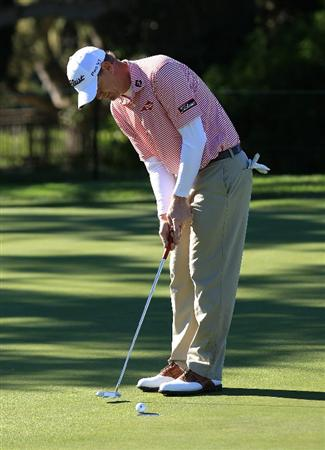 PEBBLE BEACH, CA - FEBRUARY 10:  Tom Gillis putts on the 16th green at the AT&T Pebble Beach National Pro-Am- Round One at the Pebble Beach Golf Links on February 10, 2011 in Pebble Beach, California.  (Photo by Jed Jacobsohn/Getty Images)