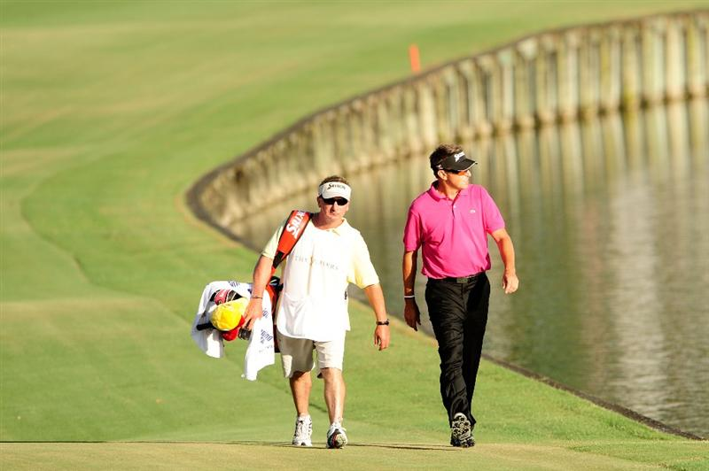 PONTE VEDRA BEACH, FL - MAY 09:  Robert Allenby of Australia walks down the 18th fairway with caddie Colin Burwood during the final round of THE PLAYERS Championship held at THE PLAYERS Stadium course at TPC Sawgrass on May 9, 2010 in Ponte Vedra Beach, Florida.  (Photo by Sam Greenwood/Getty Images)