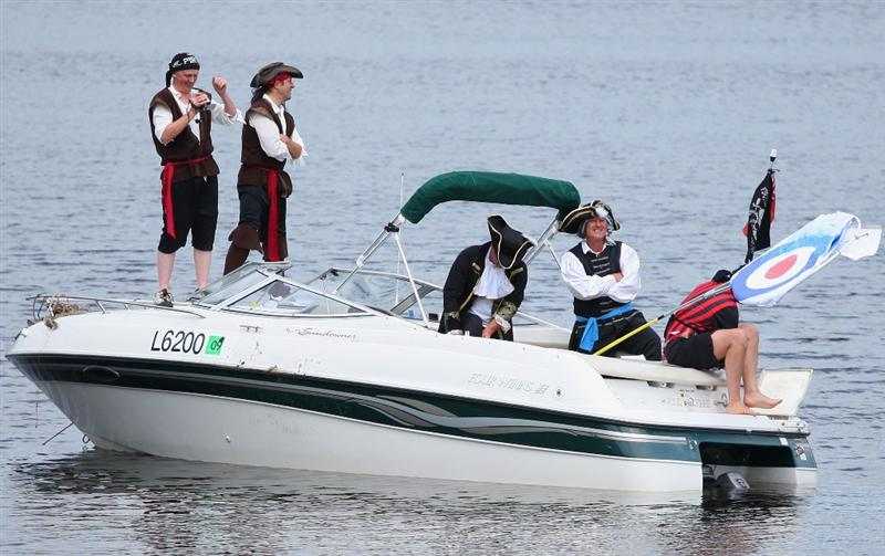 LUSS, SCOTLAND - JULY 08:  Fans in pirate costumes set up a target on their boat by the 17th green during the Pro Am prior to The Barclays Scottish Open at Loch Lomond Golf Club on July 08, 2009 in Luss, Scotland.  (Photo by Andrew Redington/Getty Images)
