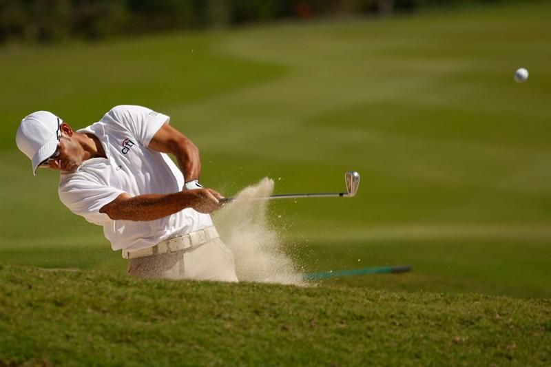 RIVIERA MAYA, MEXICO - FEBRUARY 28:  Corey Pavin makes a shot out of a bunker on the 8th hole during the third round of the Mayakoba Golf Classic on February 28, 2009 at El Camaleon Golf Club in Riviera Maya, Mexico.  (Photo by Chris Graythen/Getty Images)