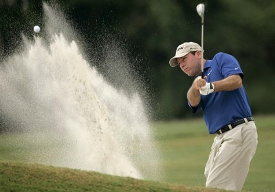 John Huston blasts from the bunker on the 9th hole during the first round of the 2006 FUNAI Classic at WALT DISNEY WORLD Resort on the Palm Course and the Magnolia Course in Lake Buena Vista, Florida, on October 19, 2006. PGA TOUR - 2006 FUNAI Classic at the WALT DISNEY WORLD Resort - First RoundPhoto by Sam Greenwood/WireImage.com