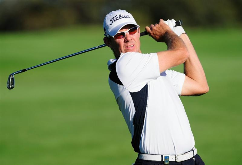 MADRID, SPAIN - MAY 30:  James Kingston of South Africa plays his approach shot on the third hole during the final round of the Madrid Masters at Real Sociedad Hipica Espanola Club De Campo on May 30, 2010 in Madrid, Spain.  (Photo by Stuart Franklin/Getty Images)