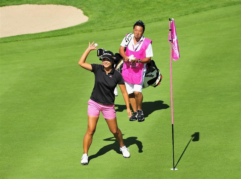 EVIAN-LES-BAINS, FRANCE - JULY 25:  Yuko Mitsuka of Japan celebrates after holing her approach shot on the 18th hole during the third round of the Evian Masters at the Evian Masters Golf Club on July 25, 2009 in Evian-les-Bains, France.  (Photo by Stuart Franklin/Getty Images)