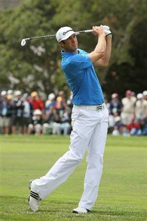 PEBBLE BEACH, CA - JUNE 20:  Dustin Johnson hits his second shot on the first hole during the final round of the 110th U.S. Open at Pebble Beach Golf Links on June 20, 2010 in Pebble Beach, California.  (Photo by Jeff Gross/Getty Images)