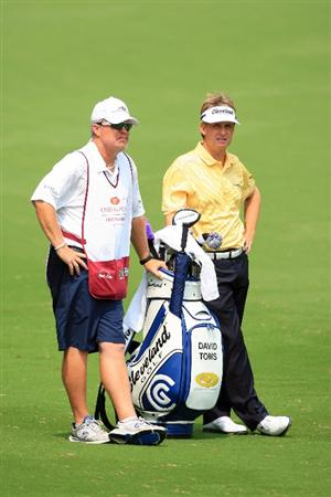 FORT WORTH, TX - MAY 22: David Toms and his caddie stand in the ninth fairway during the Crowne Plaza Invitational at Colonial Country Club on May 22, 2011 in Fort Worth, Texas. (Photo by Hunter Martin/Getty Images)