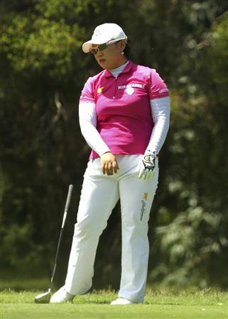MELBOURNE, AUSTRALIA - FEBRUARY 06:  Jiyai Shin of South Korea drops her club after a shot during day four of the Women's Australian Open at The Commonwealth Golf Club on February 6, 2011 in Melbourne, Australia.  (Photo by Lucas Dawson/Getty Images)