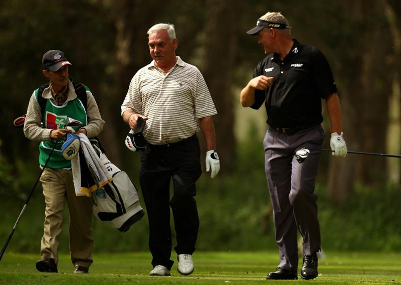 RABAT, MOROCCO - MARCH 18:  Darren Clarke of Northern Ireland (R) walks with his father Godfrey during the first round of the Hassan II Golf Trophy at Royal Golf Dar Es Salam on March 18, 2010 in Rabat, Morocco.  (Photo by Richard Heathcote/Getty Images)