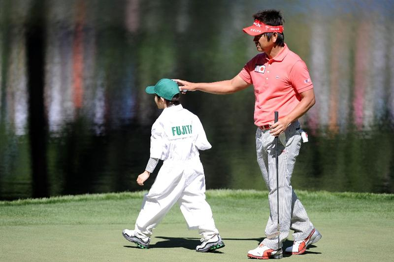 AUGUSTA, GA - APRIL 06:  Hiroyuki Fujita of Japan watches reacts after his caddie putts during the Par 3 Contest prior to the 2011 Masters Tournament at Augusta National Golf Club on April 6, 2011 in Augusta, Georgia.  (Photo by Harry How/Getty Images)