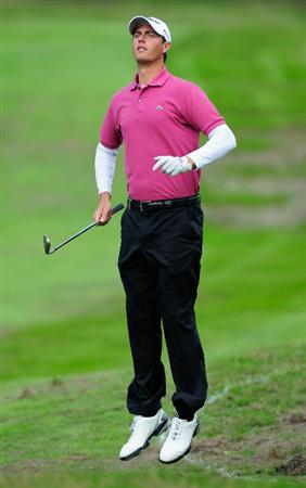 HILVERSUM, NETHERLANDS - SEPTEMBER 09: Nicolas Colsaerts of Belgium jumps to see a shot during the first round of  The KLM Open Golf at The Hillversumsche Golf Club on September 9, 2010 in Hilversum, Netherlands  (Photo by Stuart Franklin/Getty Images)